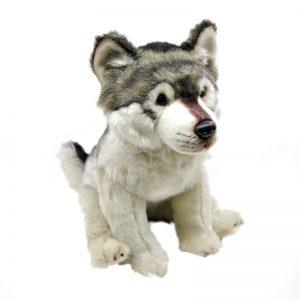 Peluche d'un loup gris assis vue mi-coté